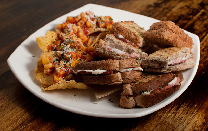 Underground Blues offers a wide range of foods and desserts, including this sandwich plate which comes with six mini sandwiches and a serving of nachos.(Salgu Wissmath/ The Sejong Dish)