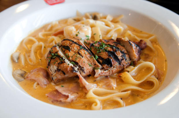 The Chicken Mushroom Cream Fettuccine features barbecued chicken, prawns, and mushrooms in a slightly sweet, creamy tomato sauce. (Salgu Wissmath/ The Sejong Dish)