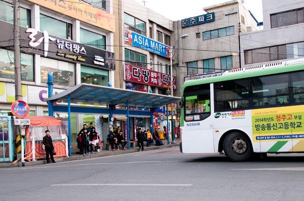 The smaller bus